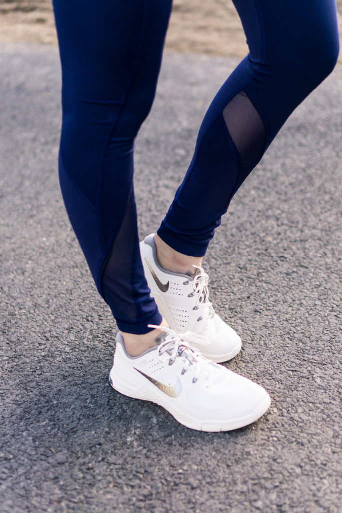 Nike metcons in summit white with navy lululemon tights