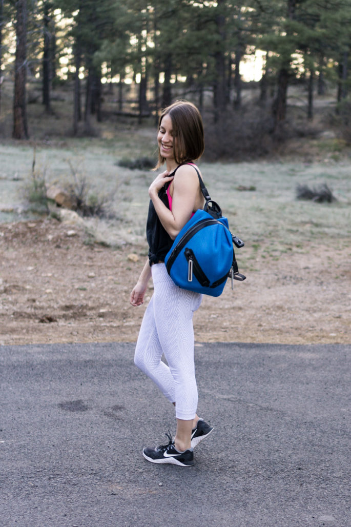 White workout crops + bright blue backpack