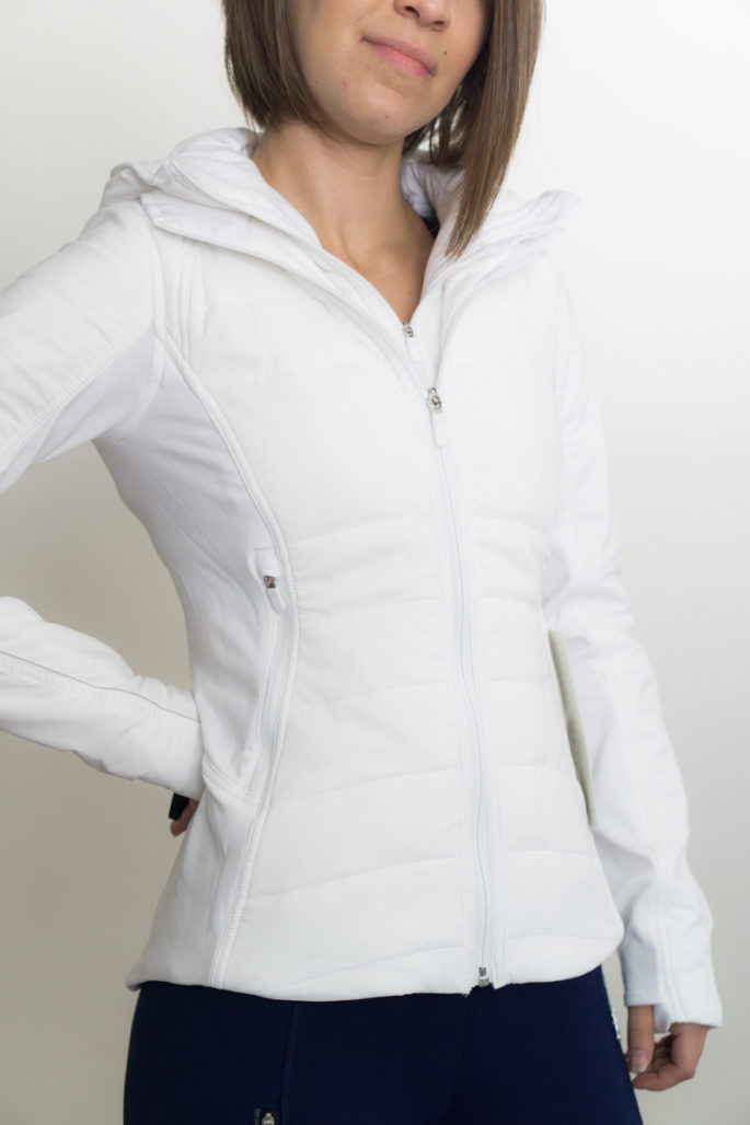 bdfbaca98fc I bought the extra mile jacket in white in my usual lululemon size (2). It  fits true to size, however you'll notice it does run a bit short. I'm only  5'3″ ...